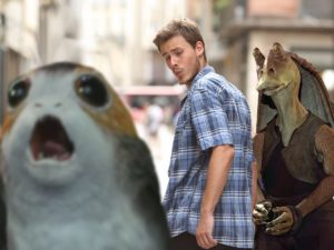 A man walking down the street, glancing backwards at Star Wars character
