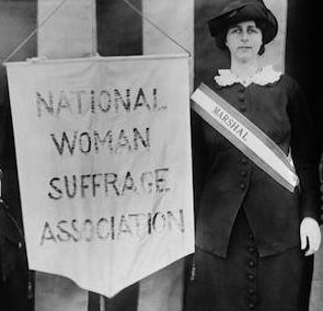 suffragists holding a National Woman Suffrage Association banner