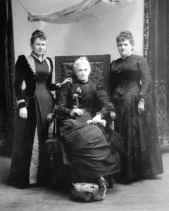 Black and white photo of Sarah standing alongside Emily S. Richards and Phoebe Beattie--two more of Utah's influential women.