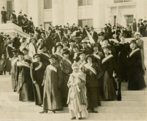 Suffragists standing on Utah State Capitol steps