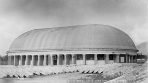Photograph of a large oval building.