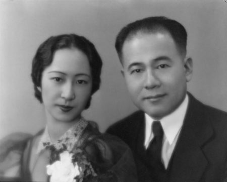 Black and white headshot of a young Asian couple.