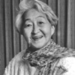 Black and white headshot of an aging Alice Kasai wearing a scarf.
