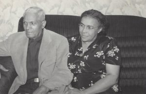 Black and white photo of Mignon with her husband, Thomas, sitting on a couch.