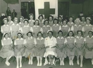 Large group photo of many female nurses with Mignon in the bottom right corner.