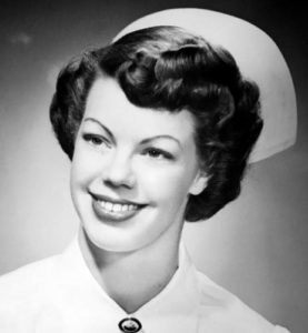 Black and white, old-style headshot of Barbara Greenlee as a nurse in the army.