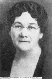 Photograph of a woman with glasses.