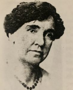 Photograph of a woman with necklace.