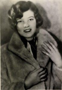 Aline Rawson Pettit wearing a fur coat.