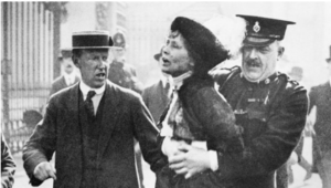 A woman being arrested by police.