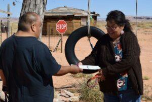 Dalene Redhorse collects a voter registration form from Kevin Blackhorse.