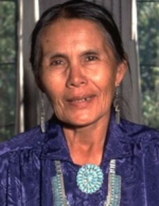 Mary Holiday Black wearing traditional Navajo jewelry.