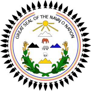 Navajo Nation Seal with the 4 scared mountains depicted.