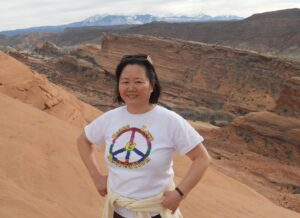 Photo shows Dr. Shuping Wang hiking in Arches National Park.