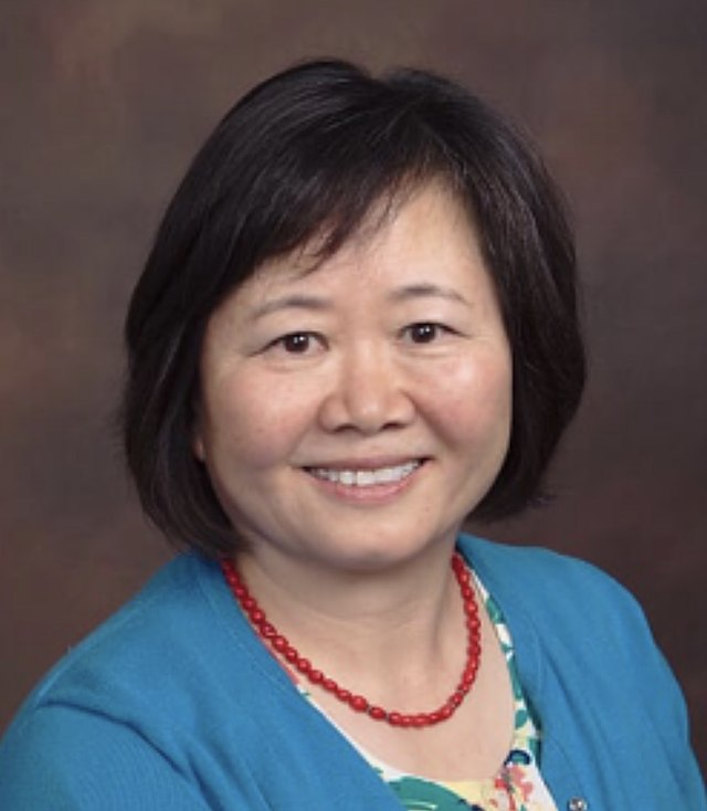 Photo of Doctor Wang smiling