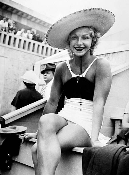Dorothy Poynton hill wears a sunhat to watch diving competition at the Berlin 1936 Olympic Games