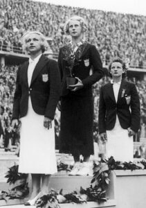 3 women on the medal stand for the 1936 Olympics